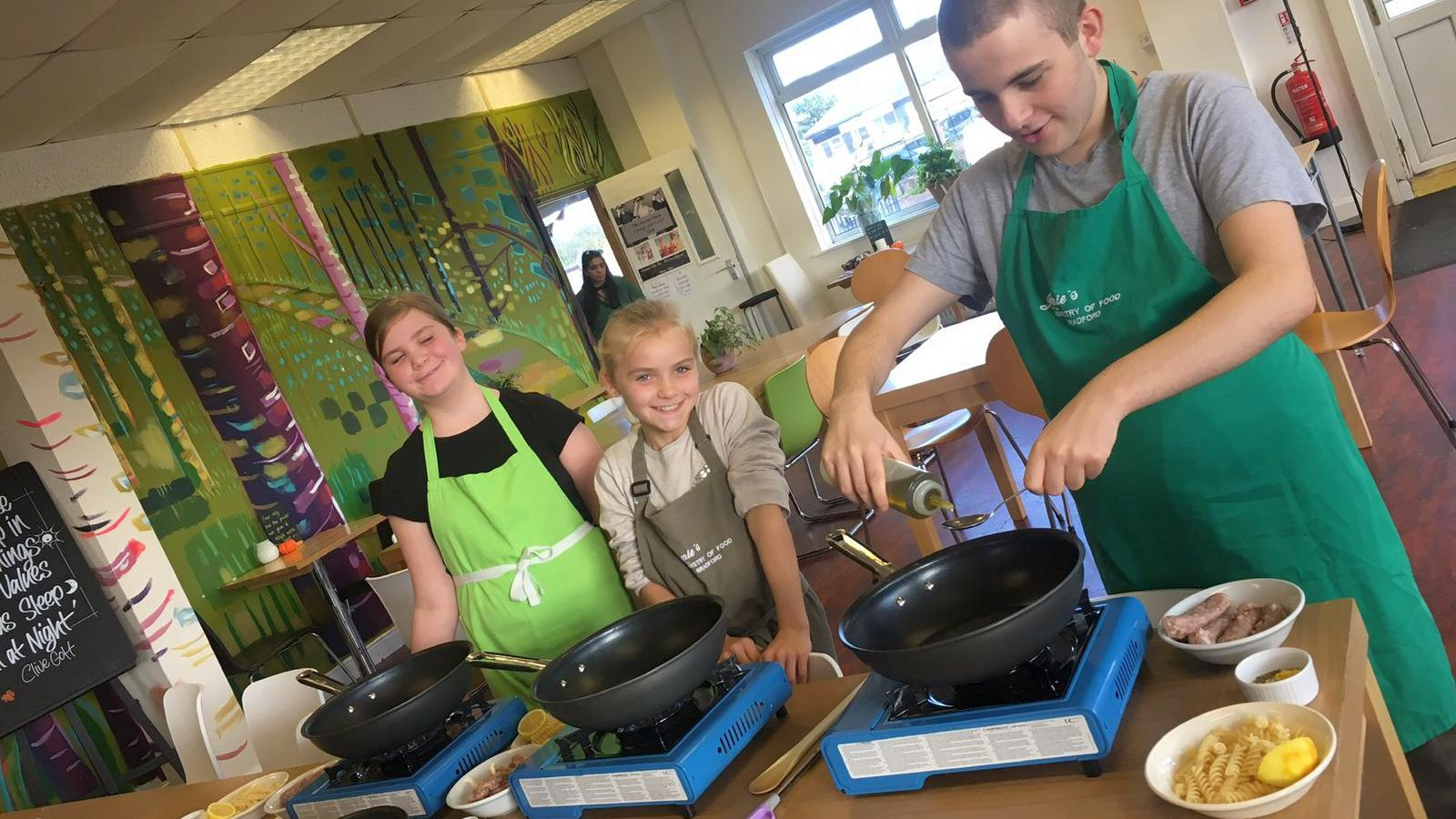 Kids cooking in the Storehouse Café