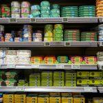 Tins of fish on supermarket shelves